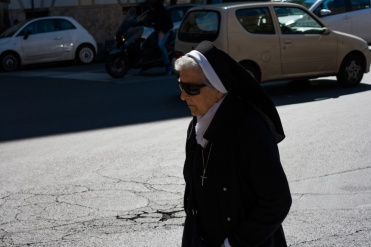 Nun walking outside the Vatican