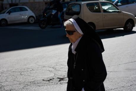 Nun walking outside the Vatican