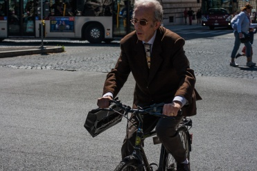 Well dressed bicyclist